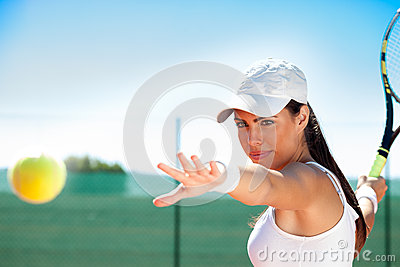 Tennis player ready to hit ball