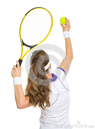Tennis player ready to serve ball. rear view