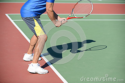 Tennis Player and Shadow on Court