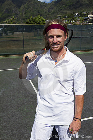 Tennis player smiles with his racquet