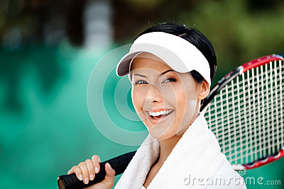 Tennis player with towel on her shoulders