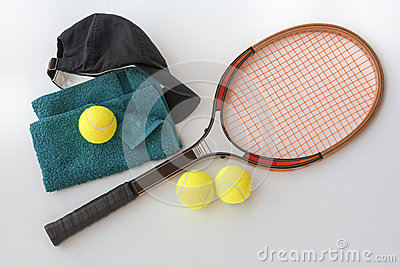 Tennis racket with balls cap and towel