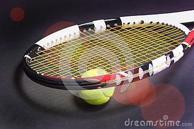 Tennis Racket with Tennis Ball on Black