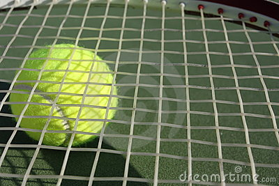 Tennis racquet with a tennis ball beneath