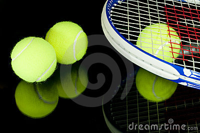 Tennis racquets and 3 balls