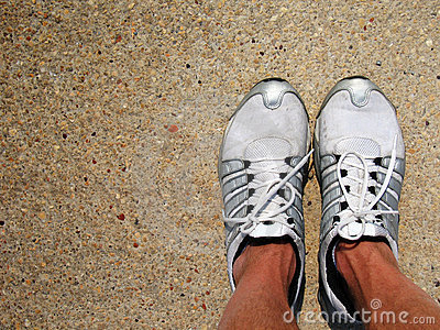 Tennis Shoes on Concrete