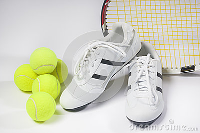 Tennis sports Concept: Raquet, Balls and Sneakers against white
