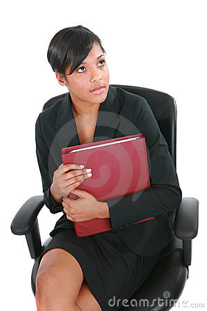 Tense Looking Female Businesswoman Sitting