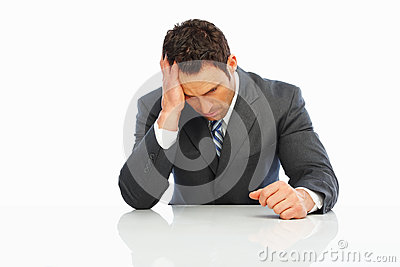 Tensed business man holding his head in pain