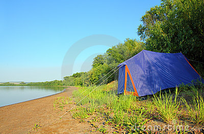 Tent on river beach