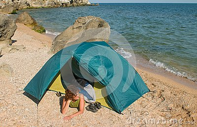 Tent on sea beach and girl