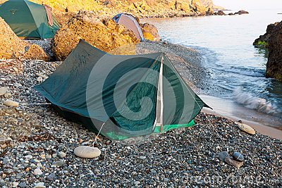 Tents on shingle beach