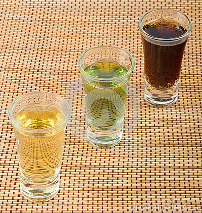 Tequila, green apple and rum shots