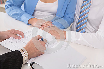Terms and conditions of contract: close up of hands signing docu