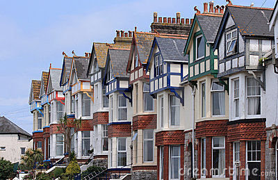Terrace of older homes with blue sky