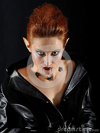 Terrible vampire woman with spiders and blood