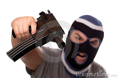 Terrorist Pointing An Automatic Weapon Royalty Free Stock Photo - Image: 21979615