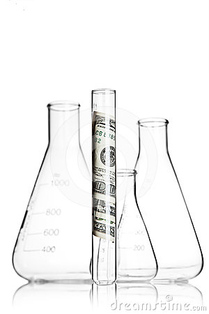 Test tube with 100 dollar bills and flasks