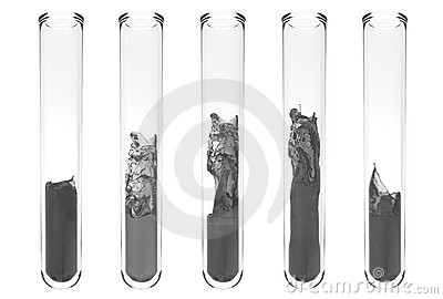 Test tubes with wavy black liquids inside