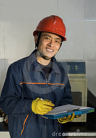 The testing worker is recording in laboratory