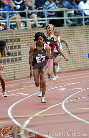 Texas A&M 4x100 Ladies relay hand off Editorial Stock Photo