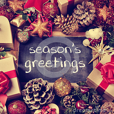 Text seasons greetings, gifts and christmas ornaments, retro eff Stock Photo