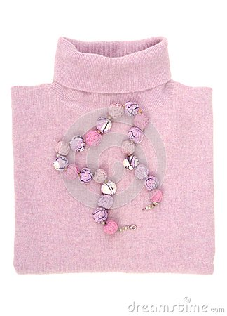 Textile necklace and wool sweater.