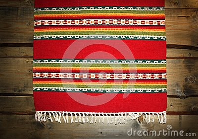 Textile traditional mat on wood backdrop