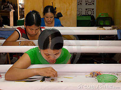 Textile workers in a small asian factory Editorial Photo