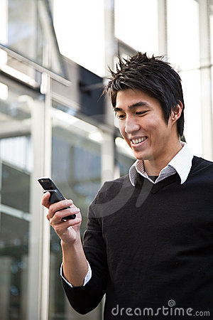 Texting casual asian businessman