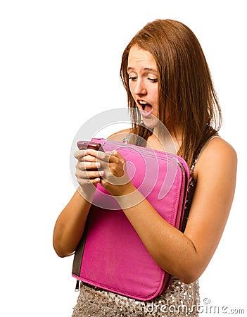 Texting teen schoolgirl reacts with shock