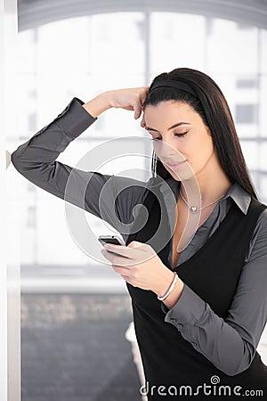 Texting woman posing