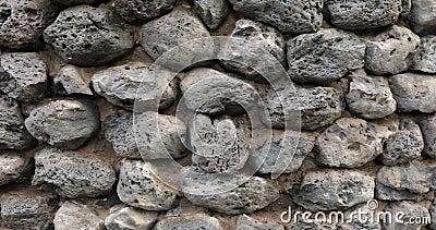A textura da parede da pedra fecha video estoque