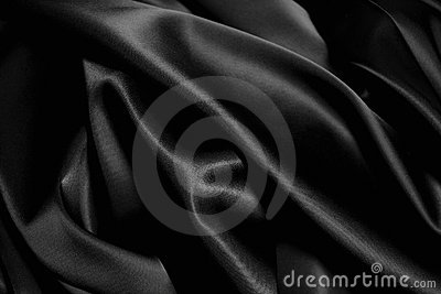Texture of a black  satin close up