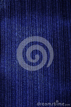 Texture fabric of dark blue color. Vertical