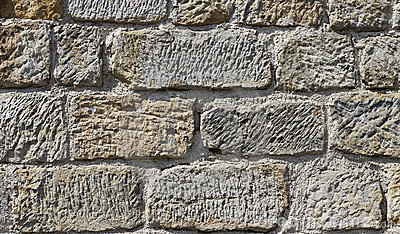 Texture of a massive stone wall