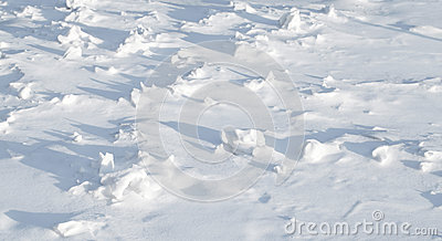 Texture of sharp hilly snowdrift