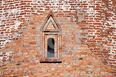Texture of wall with window of ancient fortress