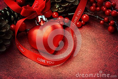 Textured Christmas background with heart ornament