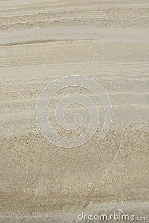 Textured tuff rock on Sarakiniko beach