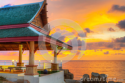 Thai architecture on the beach at sunset