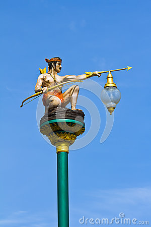 Thai art lantern pole with sky background.