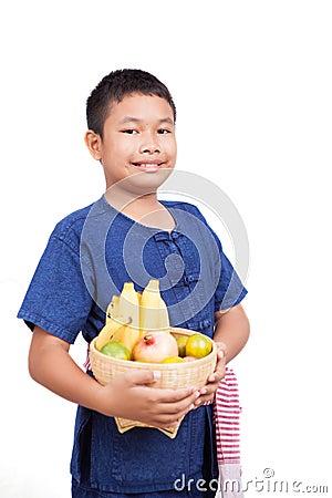 Thai boy with fruit basket