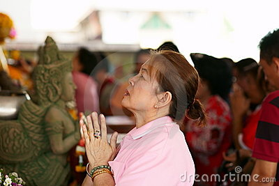 Thai Chinese Woman praying Editorial Stock Image