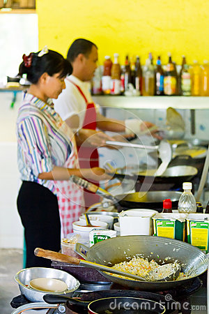 Thai cook at work in local restaurant Editorial Image