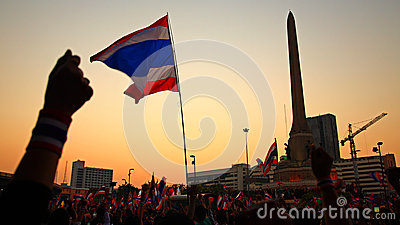 Thai flag and hands at Victory monument Editorial Image