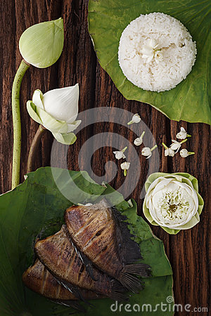 Free Thai Food Rice And Dried Salted Damsel Fish Fried With Flower Lotus Jasmine Decoration On Wooden Background Stock Photos - 98062353