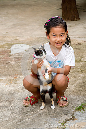 Thai girl with a cat in Koh Kho Khao Editorial Photo