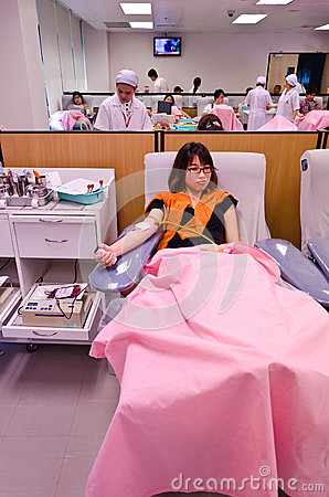 Thai girl donating blood in red cross institution2 Editorial Stock Photo