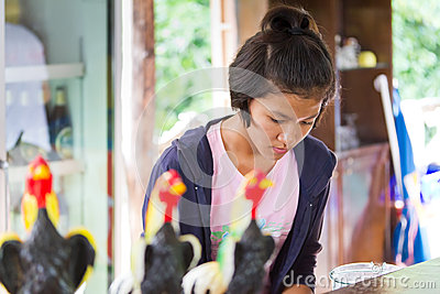 Thai girl at work on the bar in local restaurant Editorial Stock Photo